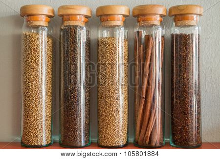 Assortment Of Spices In Glass Bottles