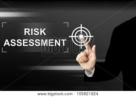 business hand clicking risk assessment button on a touch screen interface. poster