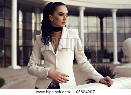 Gorgeous Woman With Long Dark Hair Wears Elegant Clothes