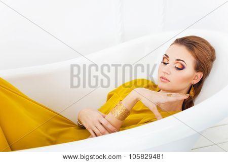 Young Beautiful Girl With Make Up Wearing Long Yellow Dress