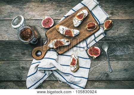 Rustic Style Bruschetta With Cheese And Figs On Napkin