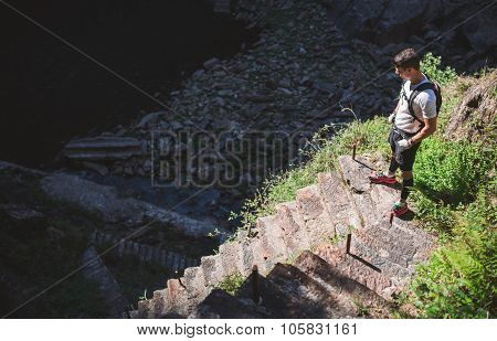 Ultra Trail Runner About To Go Down Some Stairs