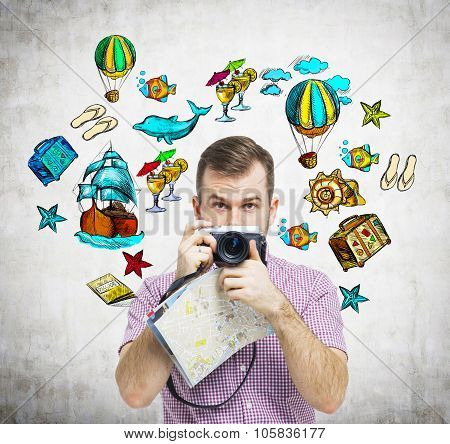 A Portrait Of Handsome Tourist In Casual Clothes Who Holds A Camera. Summer Vacation Icons Are Drawn