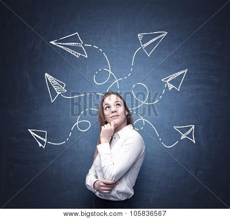 A Beautiful Woman Is Pondering About Possible Solutions Of The Complicated Problem. Many Arrows With