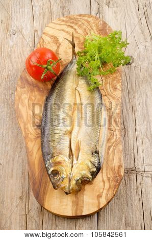 Raw Kipper On A Wooden Board