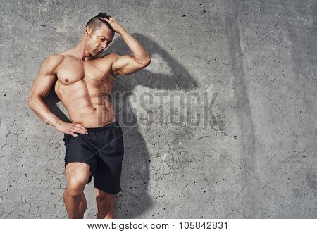 Fitness Model Portrait, Muscular Build Man Relaxing.