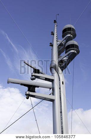 Modern control navigation. Radar and antenna on yacht bridge. Blue cloudy sky as background poster