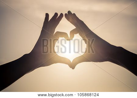 Couple Making Love Symbol In The Sky