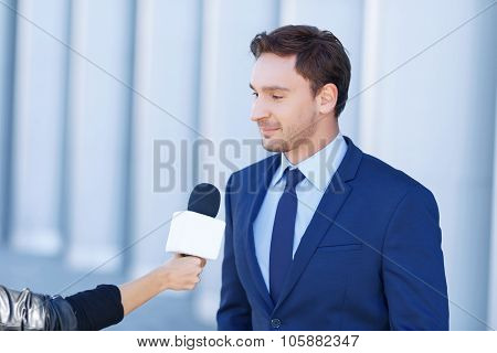 Narrator time. Young perspective gentleman is in the middle of being interviewed by a reporter. poster