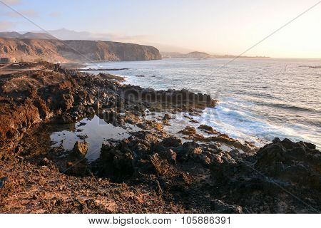 Dry Lava Coast Beach in the Atlantic Ocean poster