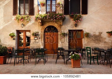 Retro romantic restaurant, cafe in a small Italian town. Vintage Italy, outdoor trattoria