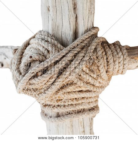 wooden structure with a thick rope closeup isolated on whote background