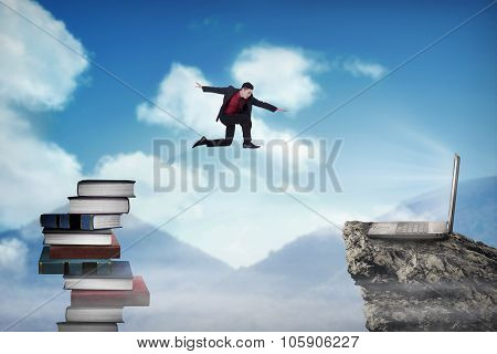 Concept of technology migration with business person jumping from book to laptop poster