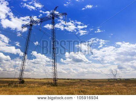 Reliance power lines in the autumn field