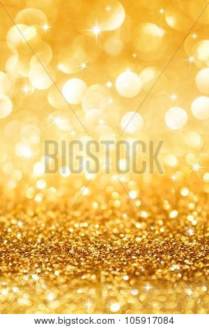 golden glitter and stars for christmas background vertical