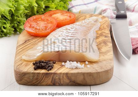 Haddock Fillet On A Wooden Board