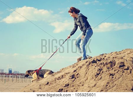 Girl and her dog in the beach hill