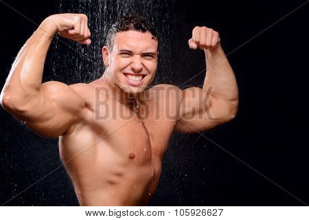 Handsome guy taking shower