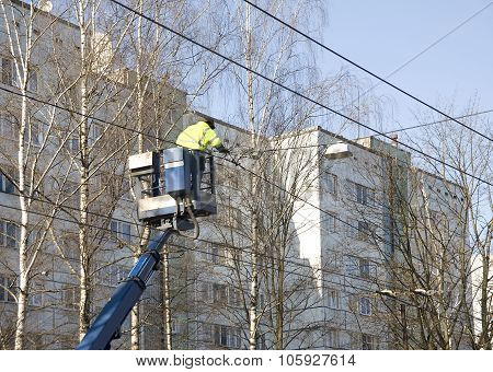 Electrician Repairs Trolleybus Wires
