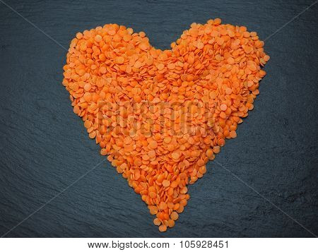 Red Lentils on Grey Slate shaped as a heart