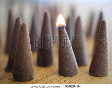 Burning incense cone closeup