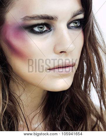 young beauty woman with makeup like shiner on face close up isolated white background, problem teen poster