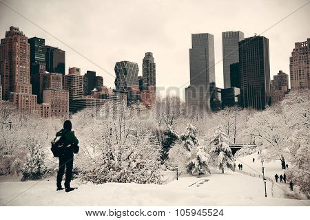 A tourist watching Central Park in midtown Manhattan New York City