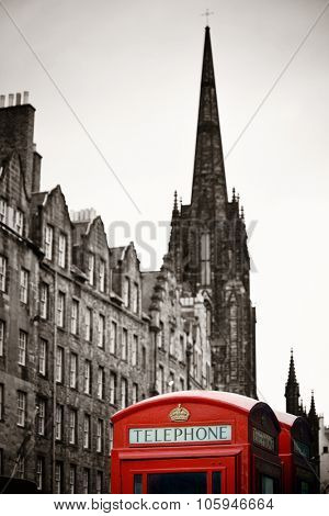 Edinburgh city street view with telephone box in United Kingdom. poster