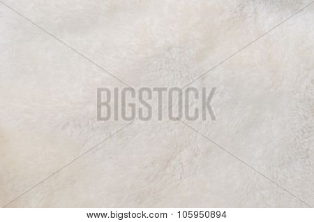Blurred background of soft tissue. Beige background of plush fabric poster