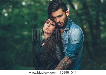 Young Couple Hugging In The Park