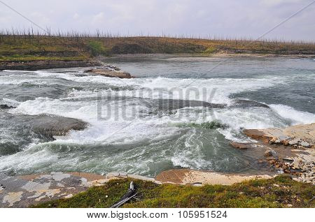 Rapids on the Putorana plateau. Rocks and jets of water Oron rapids on the Fish river Taymyr. poster