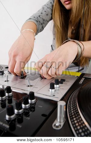 Female Dj Adjusting Sound Level