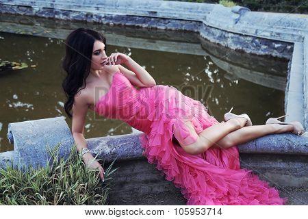 Gorgeous Woman With Dark Hair Wears Luxurious Dress And Bijou