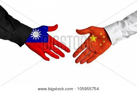 Taiwan and China leaders shaking hands on a deal agreement