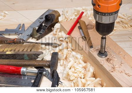 carpentry tools and wood shavings in the furniture workshop poster