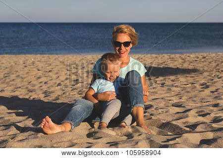 Happy family resting at beach in summer