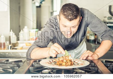 Young Chef Preparing A Tasty Meal