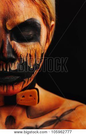 Halloween Portrait Of Body Art Pumpkin Close Eyes Girl With Pumpkin Bowtie On Black Background. Real