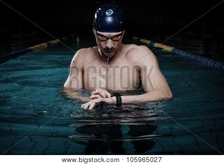 Swimmer with heart rate monitor in swimming pool