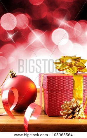 Red Christmas Decoration On A Wooden Table Vertical Composition