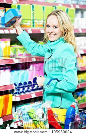 smiling woman shopping toiletries and household cleaning supplies goods.