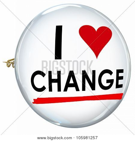 I Love Change words on a butotn or pin to illustrate embracing evolution, innovation or adaptation