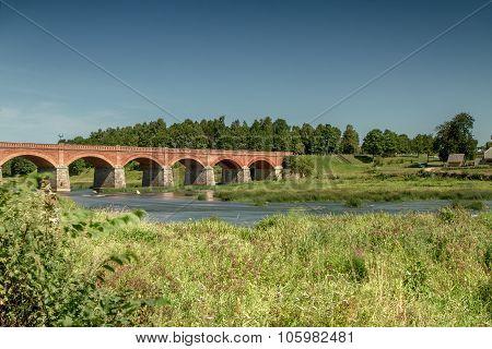 The Bridge Over The River In Latvia
