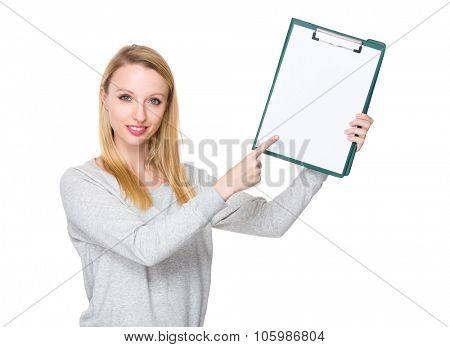 Caucasian young woman finger point to clipboard