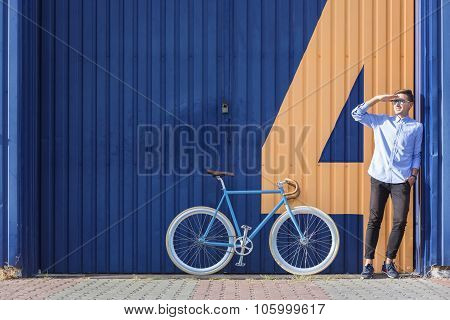 Businessman Standing Beside His Bicycle