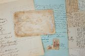 Set of handwritten antique letters close up and copy sapce on empty antique paper poster