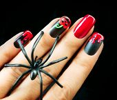 Halloween Nail art design. Nail Polish. Beauty hands. Trendy Stylish Colorful Nails and Nailpolish. Black matte polish with blood drips and pumpkin poster