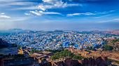 """Panorama of Jodhpur, also known as """"Blue City"""" due to the vivid blue-painted Brahmin houses. View from Mehrangarh Fort (part of fortifications is also visible).  Jodphur, Rajasthan, India poster"""