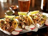 beer and mexican street tacos with radishes shot with selective focus poster