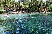 Ojo de Agua Ometepe island Nicaragua- March 31 2015: People swimming in water poster